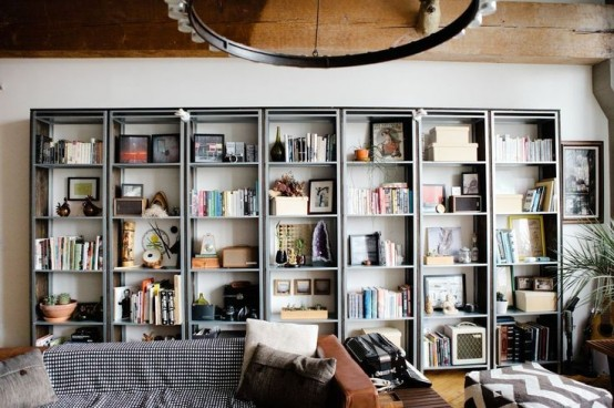 a whole library of IKEA Hyllis shelves done with books, artworks, bowls with various decor