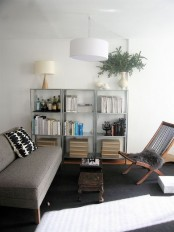 IKEA Hyllis shelves with books, boxes and a mini bar plus vases and lamps
