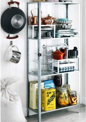 an IKEA Hyllis shelf with various jars, oils, pots, plates and kettles, such a comfy and durable shelf is great for kitchens