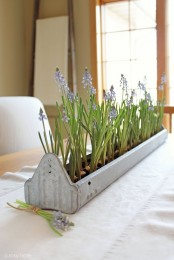 a long whitewashed planter with purple hyacinths is a lovely rustic centerpiece or just decoration in rustic style