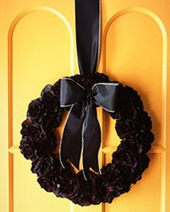 If your front door is bright and colorful then completely black wreath would look truly gorgeous on it.
