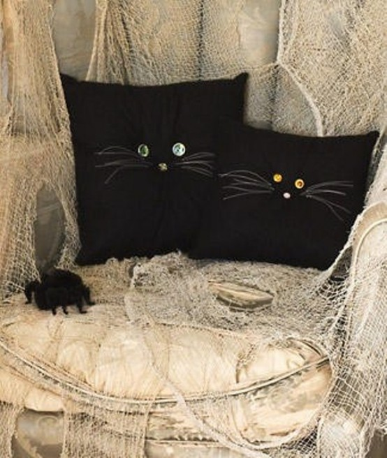 Turn your throw pillows into a cute, magical cats.
