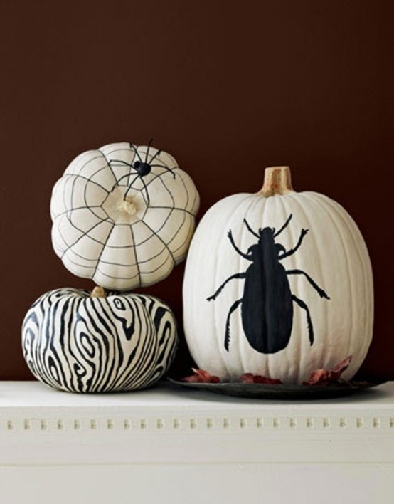 If you can't find white pumpkins, paint orange ones with several coats of white latex paint. Next, using a paint pen you can freehand-paint or stencil simple black designs on them.