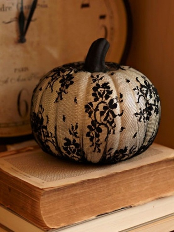 Black lace on a white pumpkin is one of those cool B&W Halloween ideas everybody could nail.