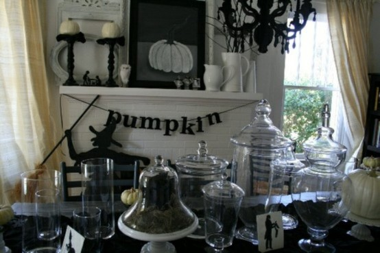 The fire place mantle is a great place to start your Halloween decorating. It's a small space so you can get creative without spending too much money or time.