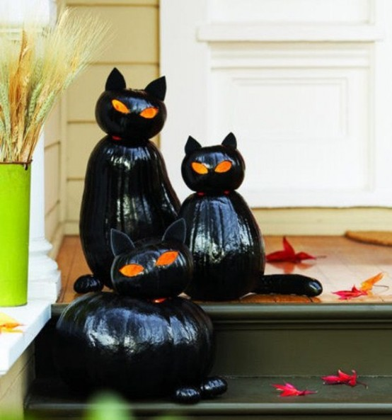 Guests and costumed kids will ascend the stairs with trepidation, unsure if they will get a trick or a treat if you decorate your porch with such creepy black cats.