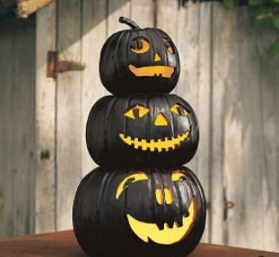 For a more original look paint your jack-o-lanterns in several coats of glossy black. You'd be amazed how cool they'd look like.