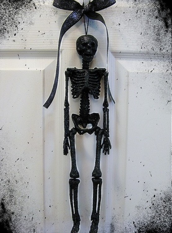 In case you aren't fond of round wreaths, you can hang a skeleton figure on yours.
