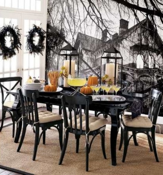 black teams with white on this table setting to give it a touch of sophistication - Sophisticated Halloween Decorations