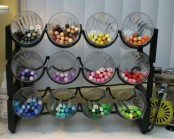 a stand with glasses is a smart and easy idea for storing pens and pencils
