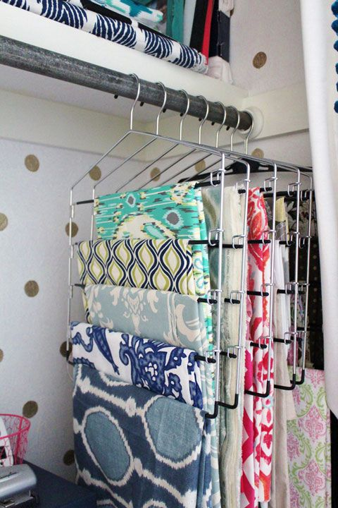 a holder with clothes hangers for fabric is a great idea for those who love sewing