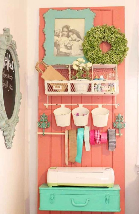 a wire storage unit and plastic buckets hanging on it is a cute idea with a vintage feel