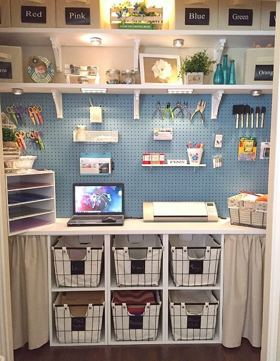a blue pegboard and several shelves with storage containers for a neat look