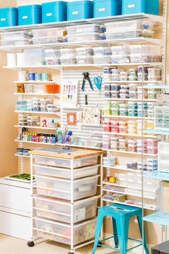 an oversized open shelving unit with little sheer containers with lids looks very neat and organized