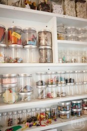 an oversized shelving unit with ltos of jars that will allow organizing small stuff
