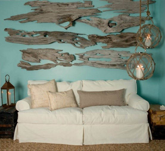 a driftwood art on the wall over the sofa plus jute and burlap for a coastal home