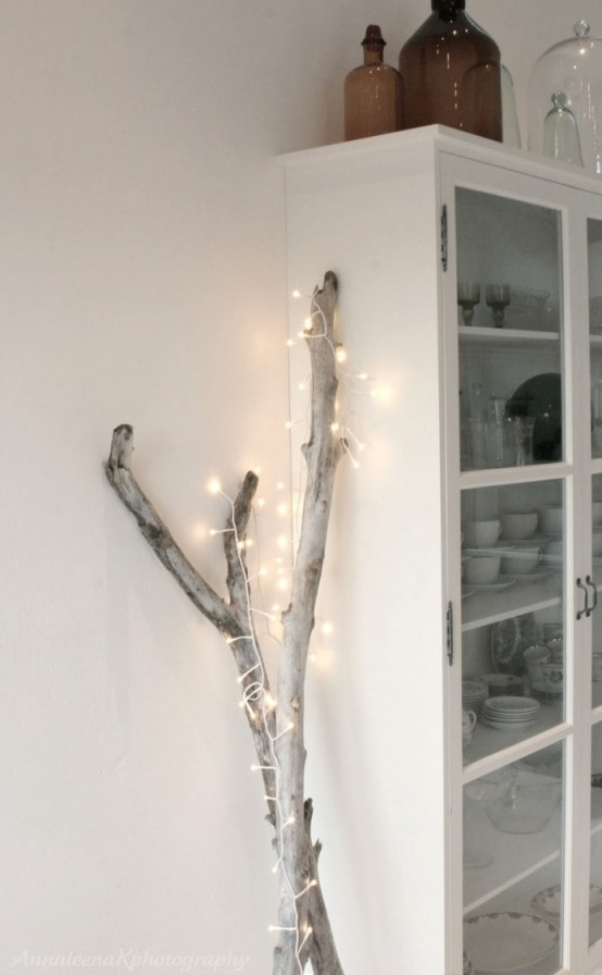 driftwood covered with lights is a cool idea for home decor