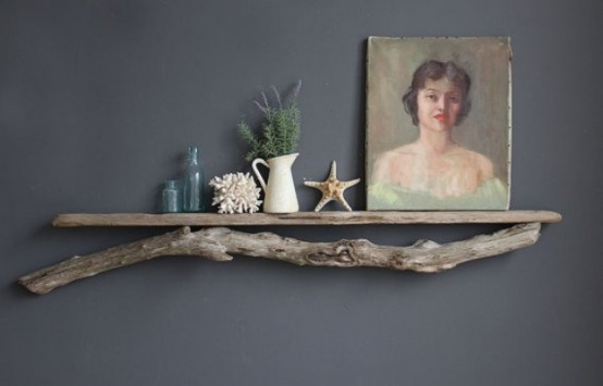 a shelf with driftwood under it brings a slight beachy feel to the space