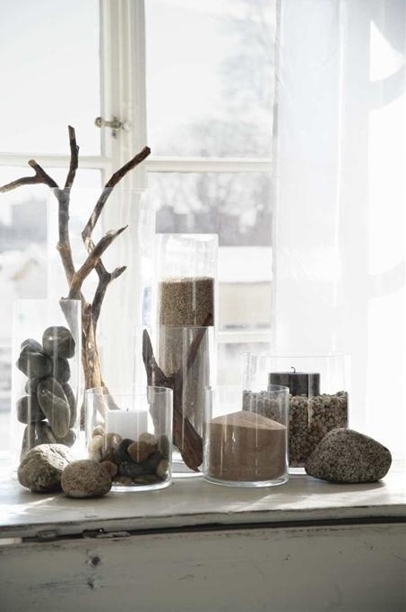 pebbles, sand and driftwood in glass jars will create a relaxed feel in your space