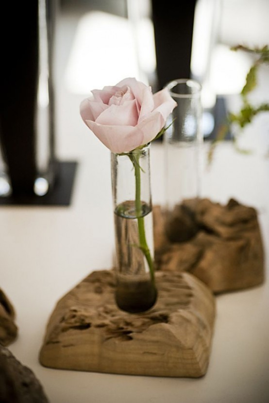 driftwood stands with little vases and blooms for chic home decor