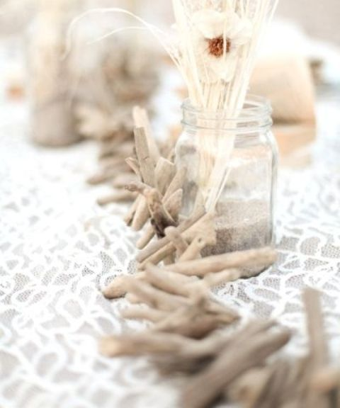 a driftwood garland can become a nice table decoration, outdoor or indoor