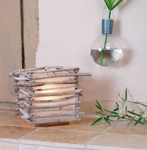a candle holder clad with driftwood is a chic coastal DIY