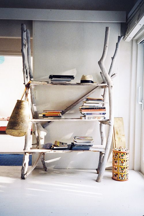 a large yet airy storage unit of shelves and driftwood is a gorgeous idea for a coastal home