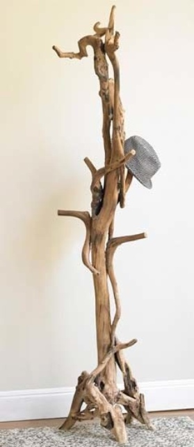 a driftwood clothes rack for a beachy or coastal entryway