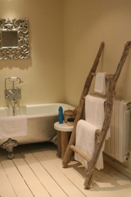 a ladder of driftwood used to hang towels
