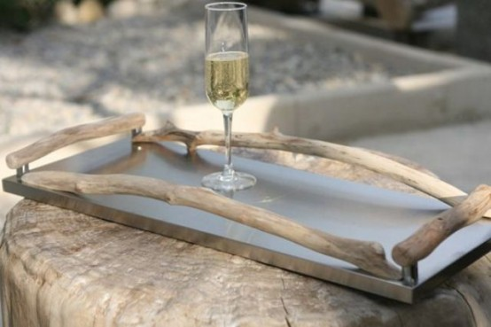 a tray decorated with driftwood for a modern beach home