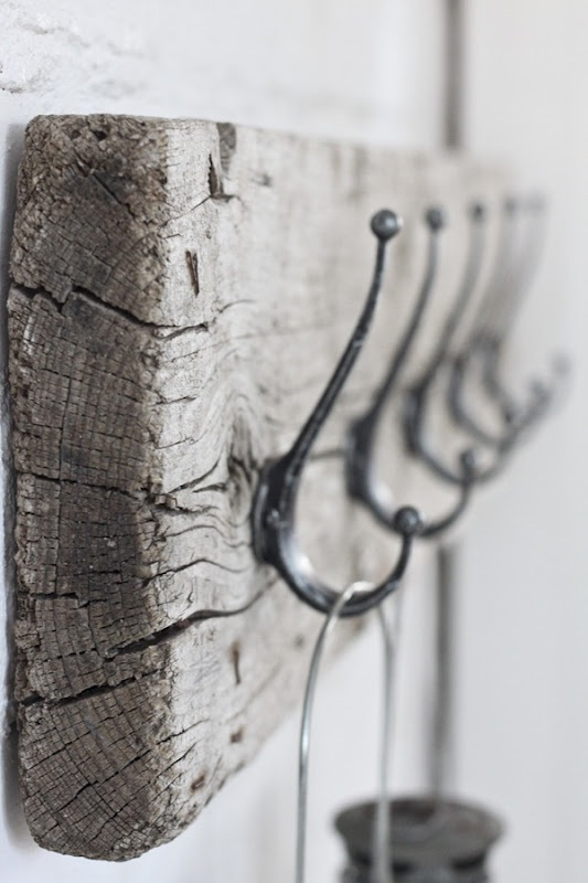 a driftwood rack with hooks will bring a coastal feel to your entryway