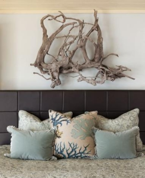 a driftwood artwork over the bed is a stylish idea for a contemporary beach bedroom