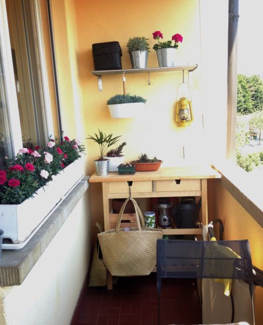 a Forhoja cart used as a storage unit in a small balcony and as a plant stand at the same time, it's very comfy in using