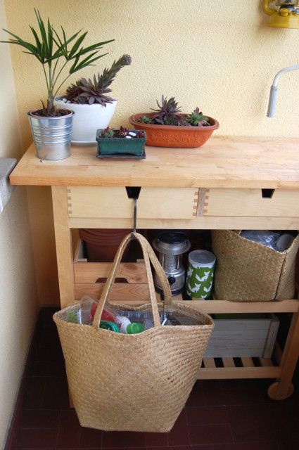 an IKEA Forhoja cart used for planting and garden works - it has enough storage space, drawers and open spaces