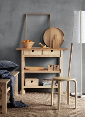 an Ikea Forhoja cart used as a usual console table – it's great for any space due to have many open and closed storage compartments