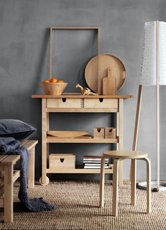 an Ikea Forhoja cart used as a usual console table - it's great for any space due to have many open and closed storage compartments