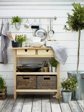 an Ikea Forhoja cart used for outdoors – for storing tableware, pots, planters, drinks and other stuff as a normal cart