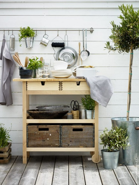 an Ikea Forhoja cart used for outdoors - for storing tableware, pots, planters, drinks and other stuff as a normal cart