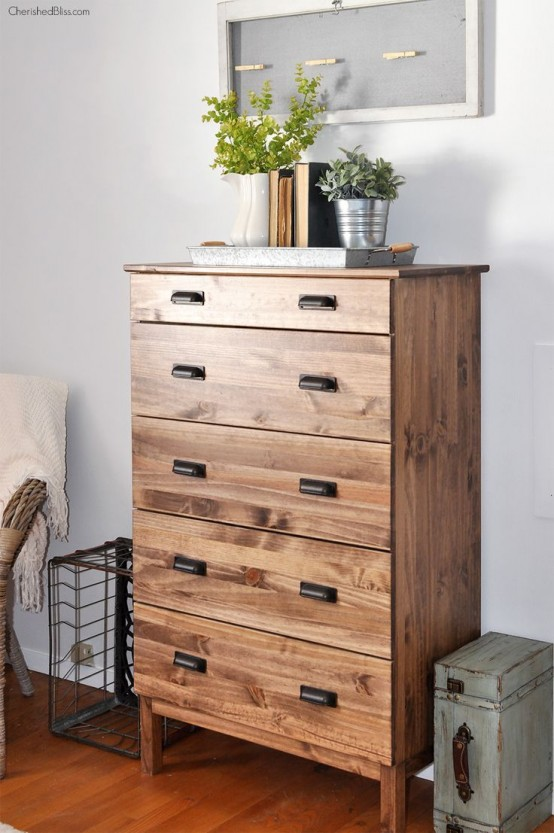 a dark stained IKEA Tarva dresser with vintage metal handles will bring a rustic feel to the space