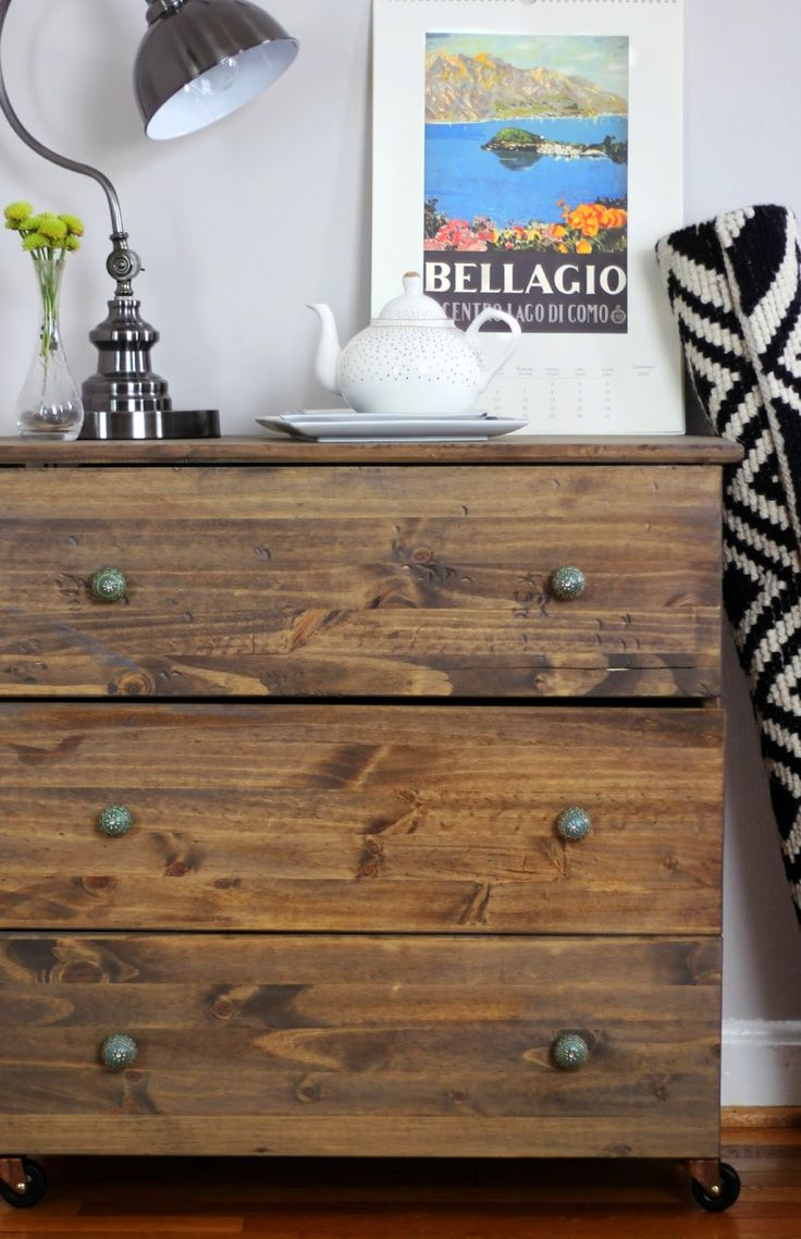 a dark stained Tarva dresser with vintage metal knobs perfectly fits a rustic space