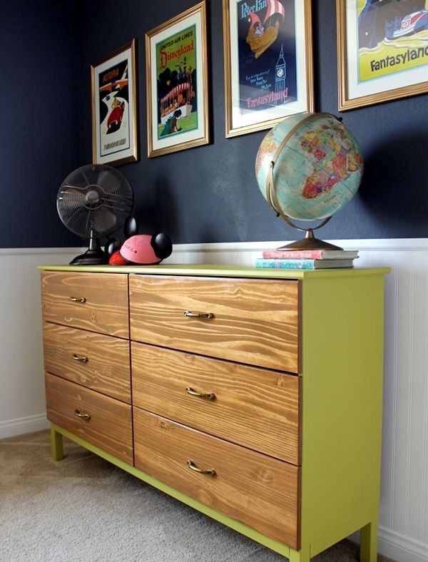 a neon yellow Tarva dresser with stained drawers and elegant metal handles for a contemporary space
