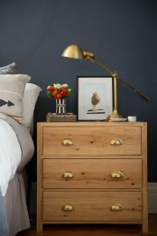 a simple and chic IKEA Tarva dresser stained light and with vintage metal handles