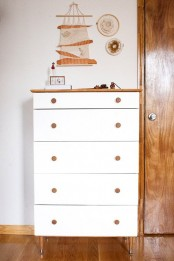 a white Tarva hack with stained legs and a stained countertop plus stained knobs looks fresh and very contemporary