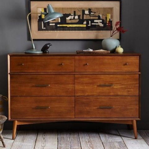 a rich stained Tarva hack with knobs and handles on legs is ideal for a mid-century modern wedding
