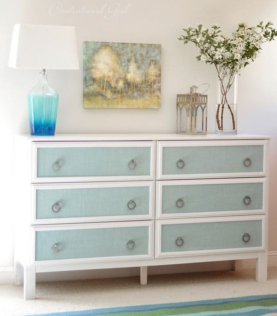 a vintage Tarva hack painted white, with blue drawers and vintage ring pulls for a vintage space