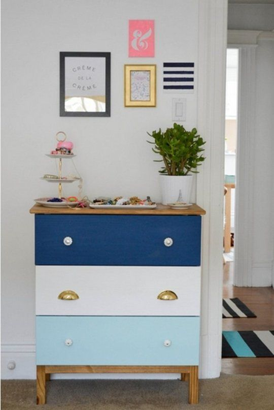 a bright Tarva hack in white, light blue and navy plus mismatching knobs, stained legs and a stained countertop