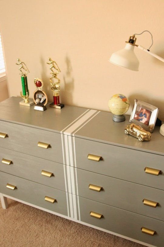 a grey Tarva hack with white stripes in the center and vintage brass knobs for a touch of elegance