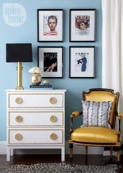 pure elegance and chic with a Tarva painted white, with gold inlays and fantastic gold knobs
