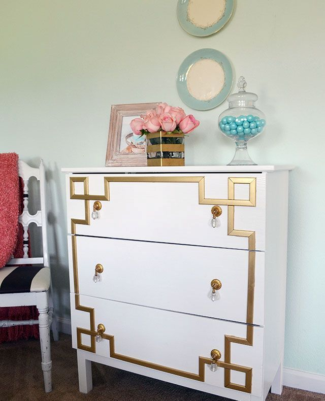 a vintage inspired Tarva dresser with gold inlays and gold and crystal pulls for a touch of art deco