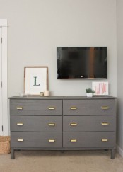a grey Tarva hack with brass retro-inspired pulls is a classic and chic storage item